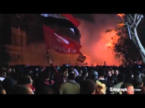 Egypt football riots: police fire tear gas at Cairo protesters in Tahrir square