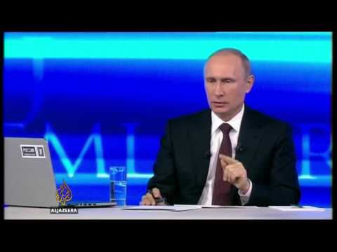 "Putin ""hopes"" for peaceful Ukraine solution"