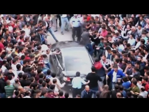 Erdogan jeered, heckled, his car attacked as he visits scene of mine collapse