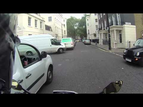 Aston Martin driver tries to intimidate biker and FAILS