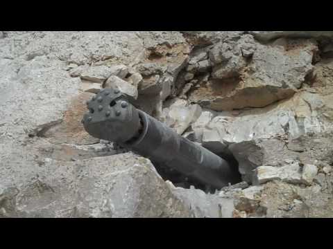 HDD Hammer HARDROCK HDDP SYSTEM Production Drilling in Rock Quarry.mp4