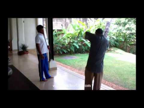 Kumar Sangakkara receives coaching tips from his father