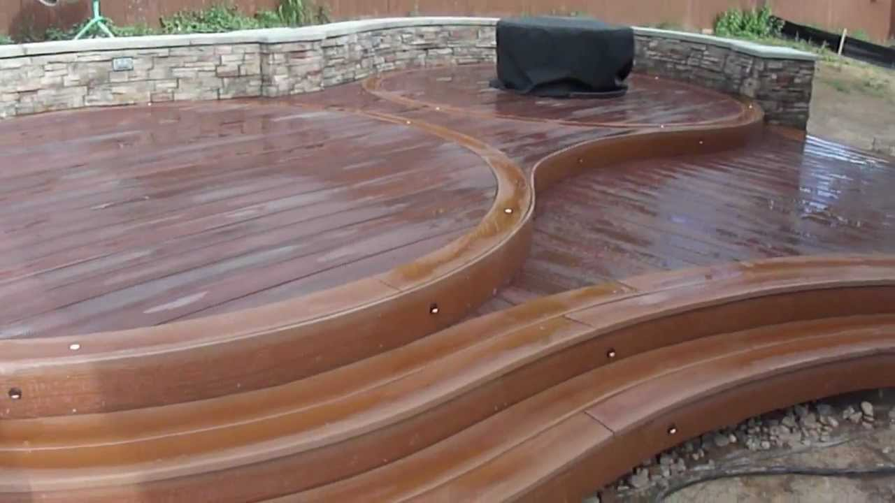 Custom circular deck by youtube for How to build a wood deck around a round pool