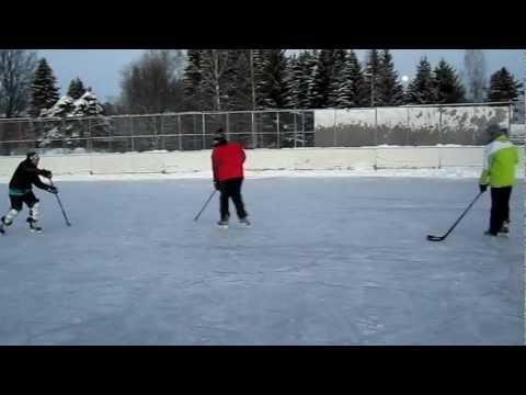 Playing outdoor ice hockey with Finnish kids in Rääkkylä