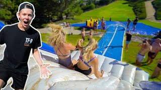 We Built A MEGA BACKYARD WATERSLIDE! (100FT+)
