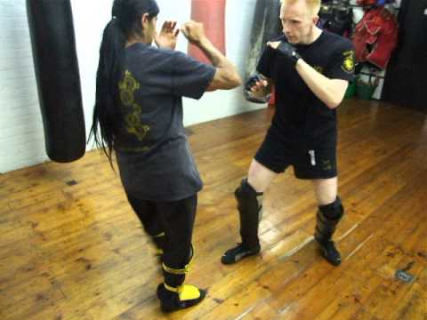 Jeet Kune Do Oblique Kick on shin pads.Kickfit Martial Arts Academy,Nottingham,UK Image 1