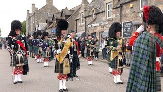 Scottish parade stops for wee dram on route to the 178th Tomintoul 'friendly' Highland Games
