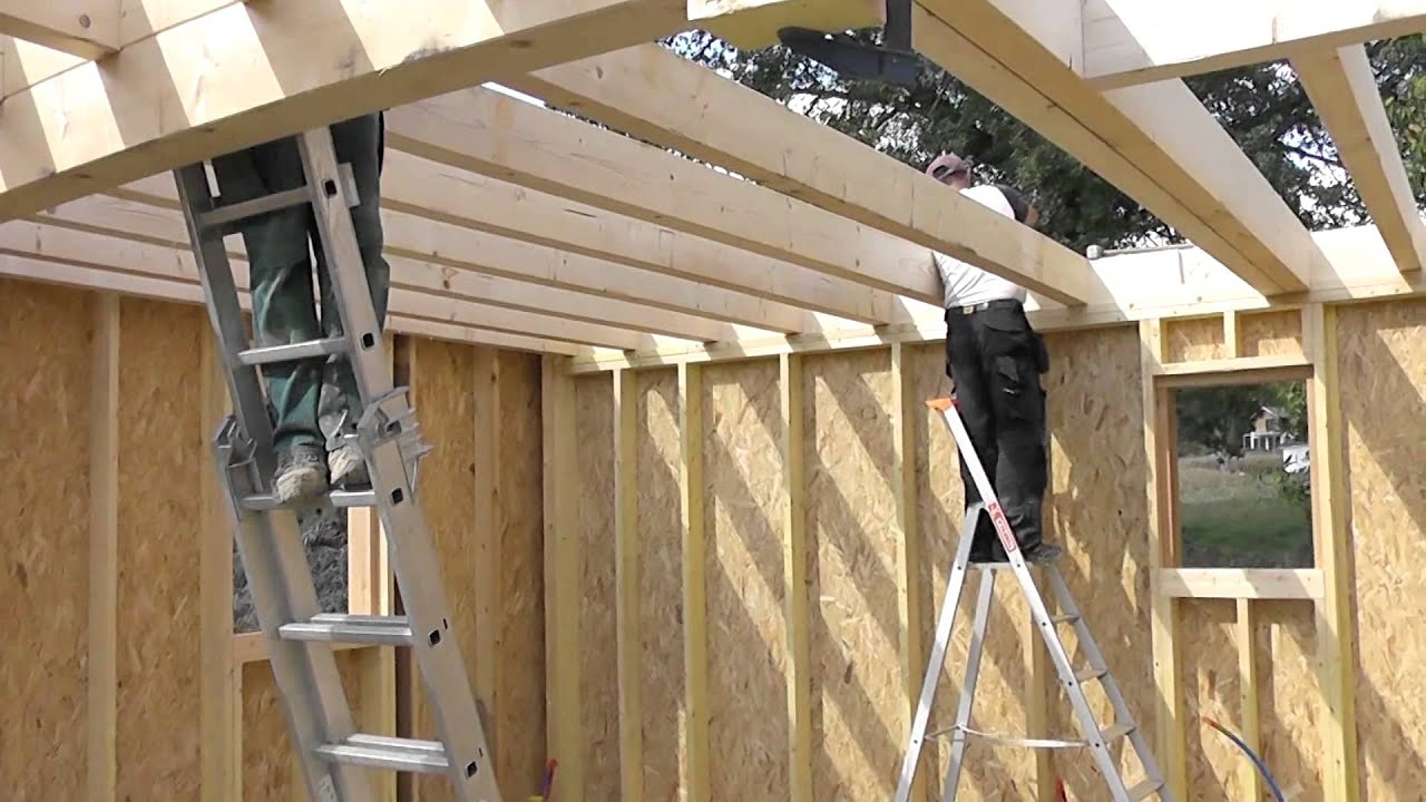 Les tapes de construction d 39 une maison en bois youtube for Construction bois maison
