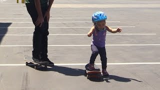 TEACHING A 2 YEAR OLD TO SKATEBOARD!