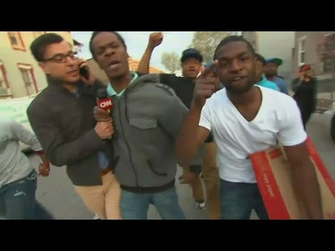 Baltimore protesters confront CNN\'s Miguel Marquez as he tries to report from inside the protests in Freddie Gray\'s neighborhood.