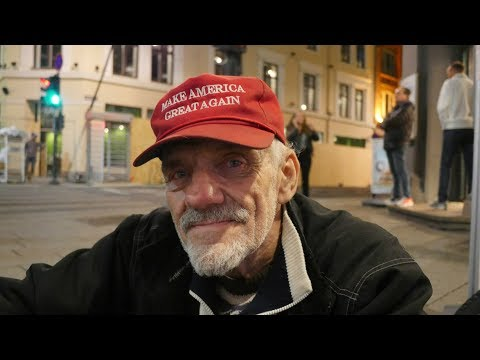 Homeless Man in Oslo, Norway Wearing a Donald Trump Make America Great Again Hat.