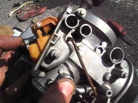 How to adjust motorcycle carburetor floats.