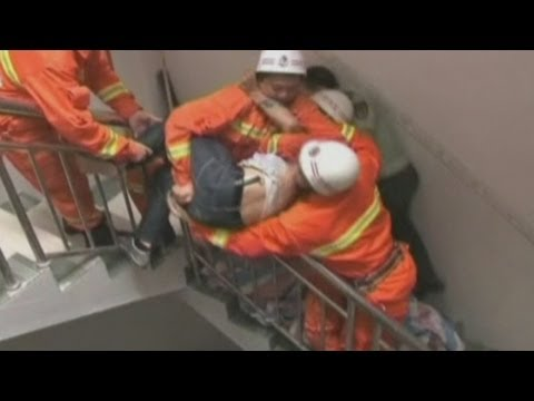 Amazing footage: Suicide jumper in China caught in mid-air by firefighters