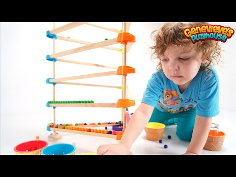 Genevieve Teaches Colors with a fun Wooden Marble Maze!