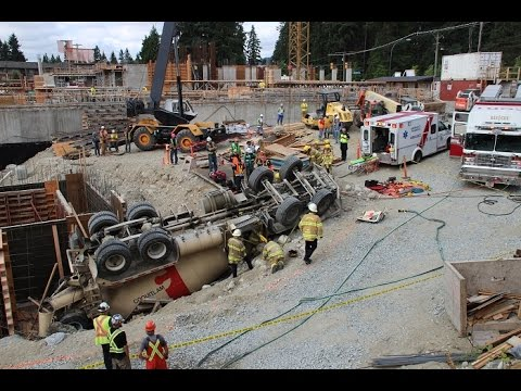 Concrete truck rolls over on construction site in Coquitlam, BC