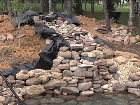 Pond waterfall how to save money and do it yourself for Build your own waterfall pond