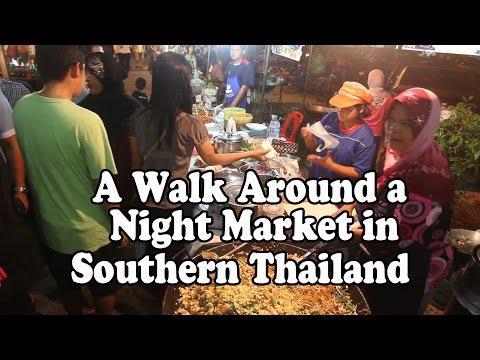 Street Food at a Night Market in Southern Thailand. A walk around a Thai market in Satun. Thai Food