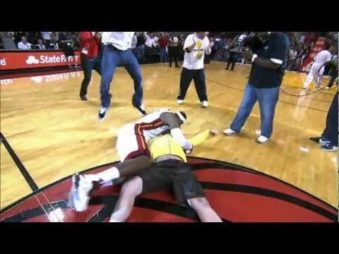 LeBron tackles Heat fan who hits $75000 shot!