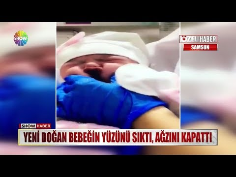 Yeni doğan bebeğin yüzünü sıktı, ağzını kapattı