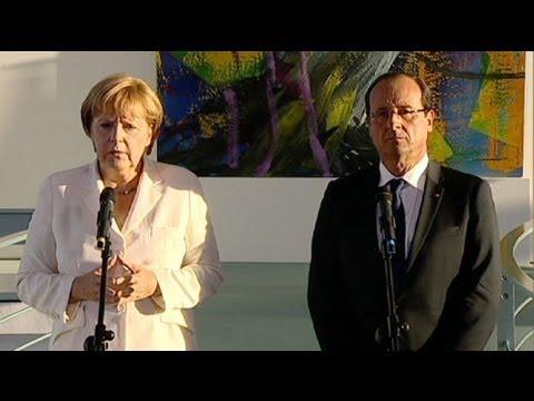 هولاند وميركل في برلين لتباحث أزمة اليورو والأزمة