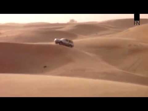 Desert Safari Driving - Toyota Land cruiser speed up on the dunes - Abu Dhabi UAE