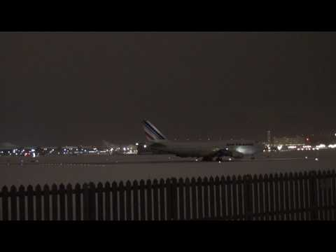 JUMBO JET BLASTS SNOW ON A WINTER STORMY NIGHT TAKEOFF