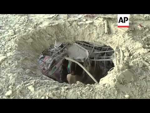 Buildings turned to rubble after Israeli troops battled Hamas militants in Gaza on the second day of