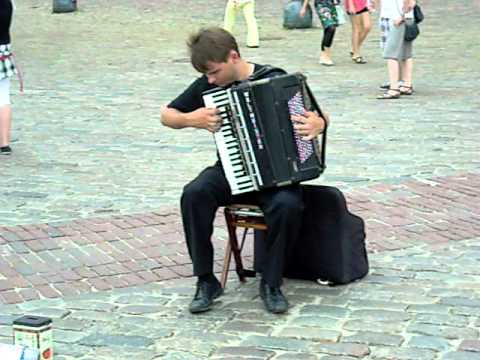 Street artist playing Vivaldi on accordion