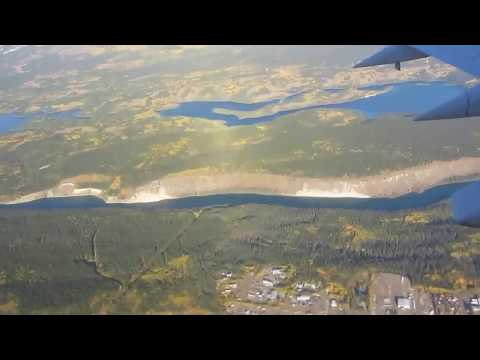 The city of Whitehorse in the Yukon Territory in August and September, 2013. Approaching from the North over the Yukon Rive on a beautiful Day. Air North at ...