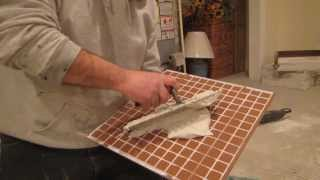 How to back butter a tile