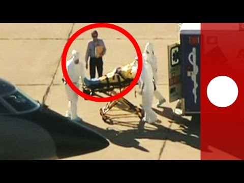 Spotted: Unprotected man transfers Ebola patient onto plane without hazmat suit (Dallas)