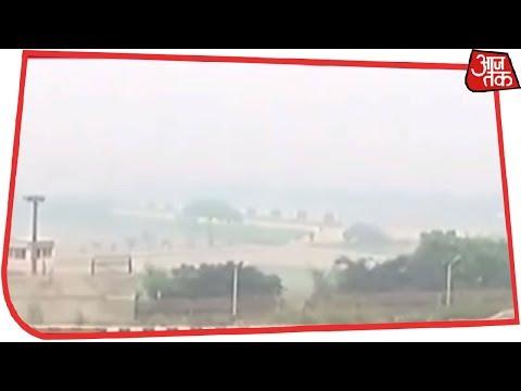 दिल्ली में घना कोहरा और तापमान में गिरावट