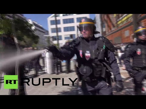 Clashes in Paris as riot police evict migrants from make-shift camp