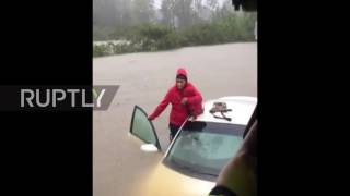 USA: Police rescue toddler trapped in half-submerged car after Hurricane Matthew