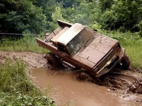 MUD TRUCKS HUGE CHEVY 4X4 on TRACTOR TIRES GETS STUCK DEEP TWICE!!