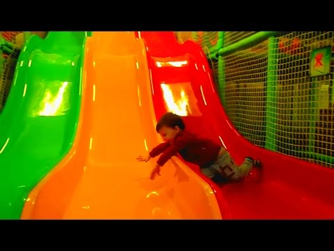 Children play with toys, slides, plastic balls Playground for kids full of fun