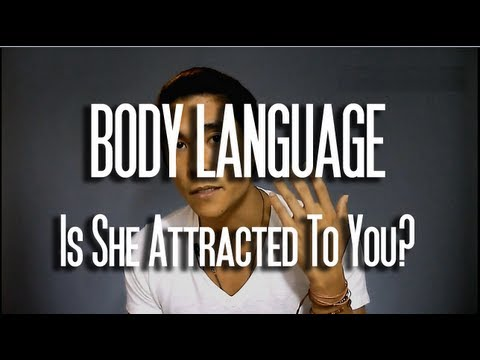 how to tell if a woman is attracted to you body language
