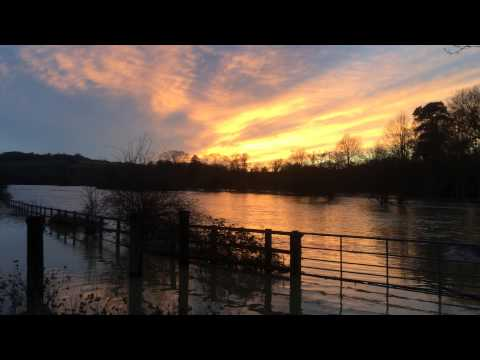 The River Mole in Leatherhead Surrey on Christmas Eve 2013 at Sunset flooded
