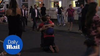 England fans take to the streets of London after defeat