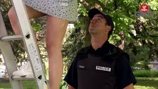 Police Officer Looks Up Woman's Skirt