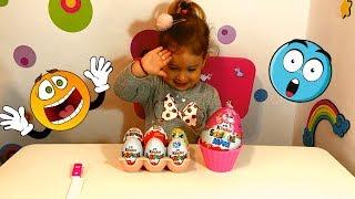 Sofi opening Kinder surprise eggs (Sofi deschide oua Kinder cu surprize)