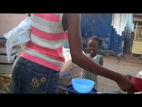 Girl buys bread in Newtown, Accra, Ghana