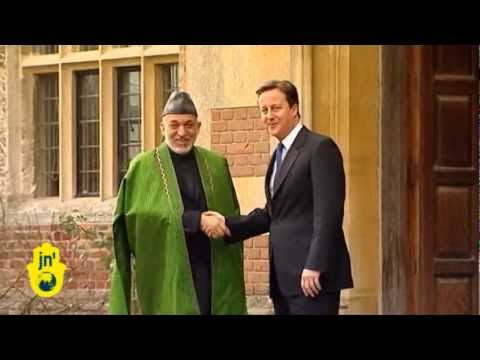 France's Sarkozy wants Afghan exit: PM David Cameron cautions divided NATO as Karzai visits London