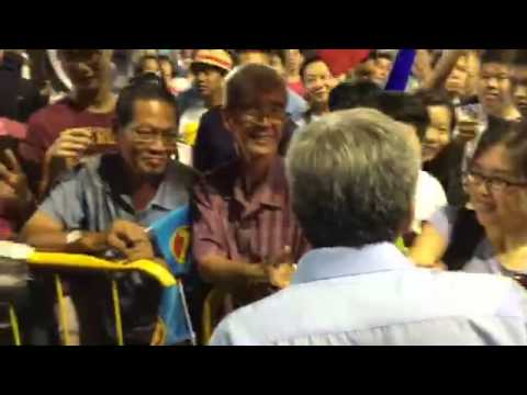 WP's Png Eng Huat shaking hands with supporters