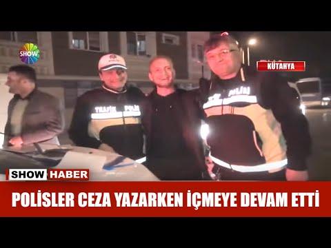 Polisler ceza yazarken içmeye devam etti!