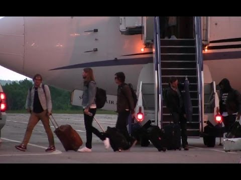 American pop rock band Maroon 5 lands in style at Gander International Airport in a Swiftair Boeing 737-4B7 for the 2014 Exploits Valley Salmon Festival. The band members consist of Adam Levine,...