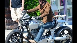 2014 Keanu Reeves rides a fancy chrome motorcycle with friends along Sunset Boulevard
