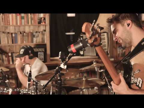 Evan brewer of the faceless performs contraband at the emg studio