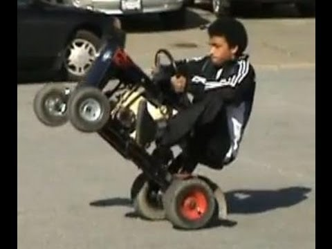 Afroman on Mini Tractor Does Wheelies While Picking His Fro