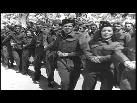 The Yugoslav Partisans dance and sing in Yugoslavia during World War II. HD Stock Footage